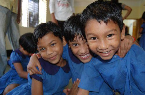 children in Bangladesh. They visit a school from Enfants du Monde's education project